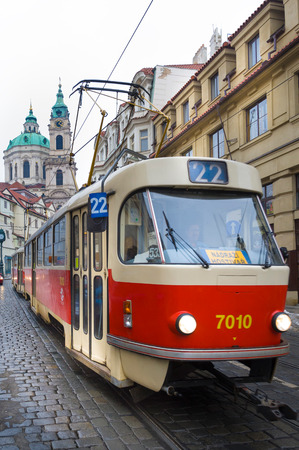 PRAGUE, CZECH REPUBLIC - FEBRUARY 24, 2013: Famous red tram in Prague. Prague - Czech capital. Population - 1.3 million people (2013).
