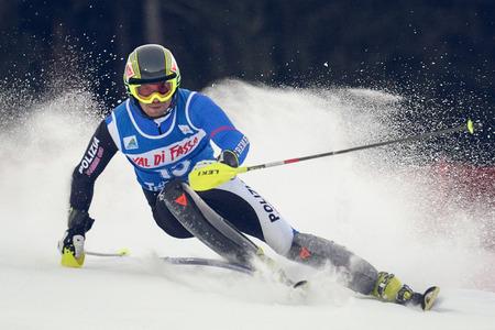 POZZA DI FASSA, ITALY - DECEMBER 30: Unidentified participant of ski race performs at Italian Slalom Championship on December 30, 2012, Pozza di Fassa, Italy Editöryel