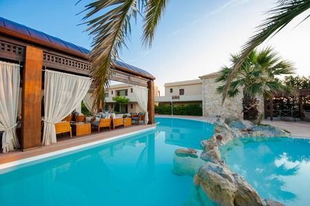 Paralia Katerini, Greece - June 02: Swimming pool of luxury hotel on coast of Mediterranean sea on 02 June 2011, Paralia Katerini, Greece