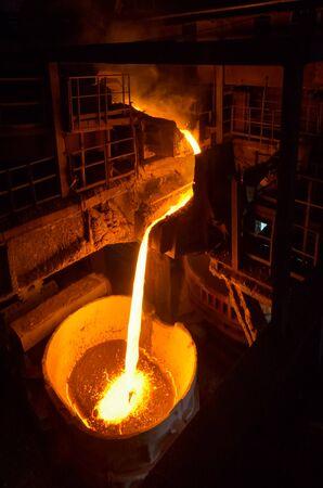 Liquid iron inside of plant and trains photo