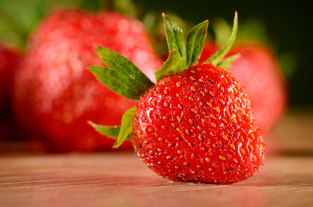 photo of delicious strawberries on wooden table