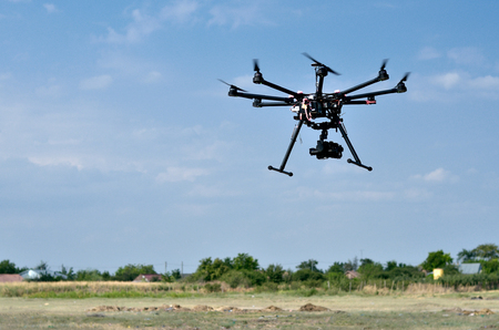 spy camera: flying drone with camera on the sky Stock Photo