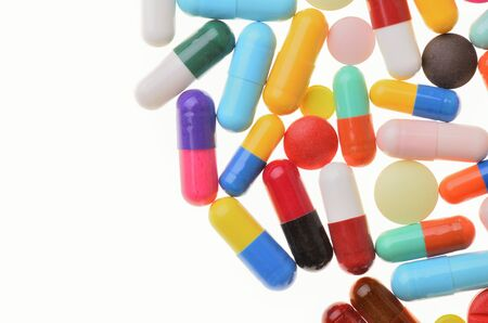 Many colorful pills isolated on white Stok Fotoğraf