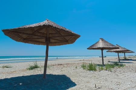 View of nice tropical empty sandy beach with umbrella Stok Fotoğraf