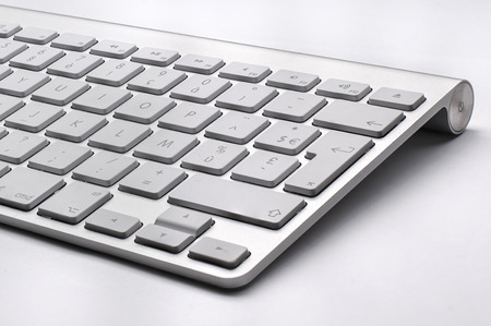 BUCHAREST, ROMANIA - JAN 7, 2015 Close up of the typical Mac Keyboard of an Apple wireless Computer