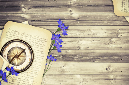 Cornflower: Wooden Travel Background With  Compass, Cornflowers and Old Letter  Stock Photo
