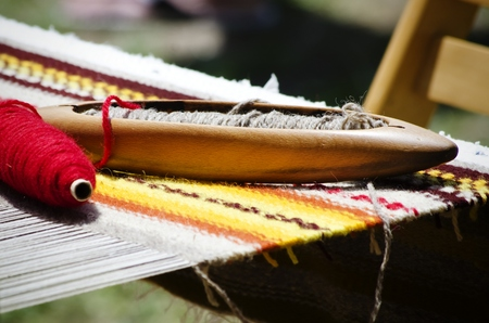 weaving: Photo of the Loom Tools and Wool Fabric