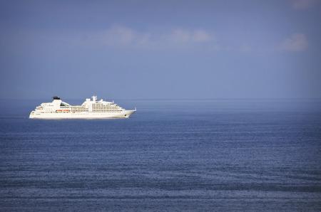anchoring: Cruise Ship at Sea Horizon Over Cloudy Sky