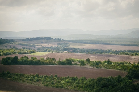 rolling landscapes: Agricultural Valley in Cloudy Day