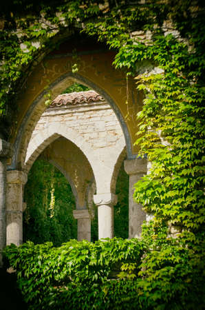 green building: Vintage Stone Gothic Arc in Greenery