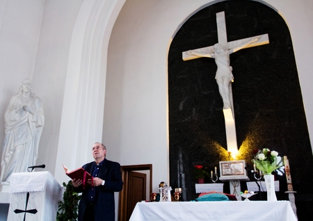 resurrect: Catholic priest reading liturgy during Easter mass
