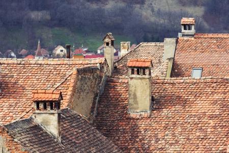 shingle: Whispering chimneys on shingle rooftops