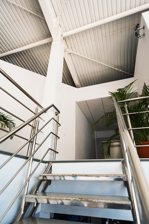 crossbars: Stairs to an office placed in an industrial hall Editorial