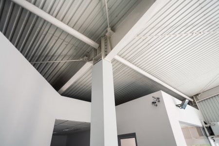 crossbars: Structure of a pillar inside a white industrial hall Editorial