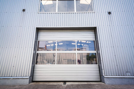 Sliding door with window of an industrial white hall photo