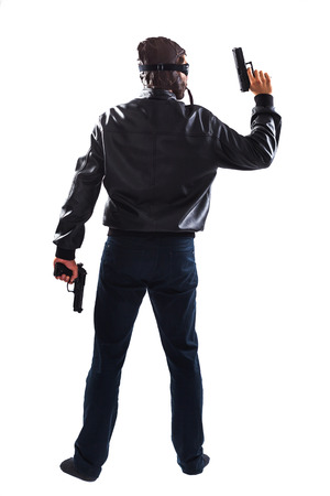 endangering: Dangerous tall man holding two guns in his hands is endangering people - isolated on white
