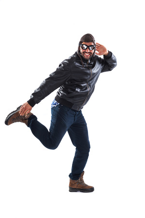 fooling: Funny young man wearing black leather jacket and vintage cap and glasses is fooling around - isolated on white