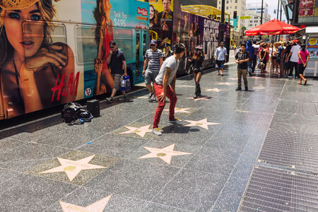Los Angeles, CA, USA - may 2013: Tourists walking by Hollywood Walk of Fame live show in a sunny day