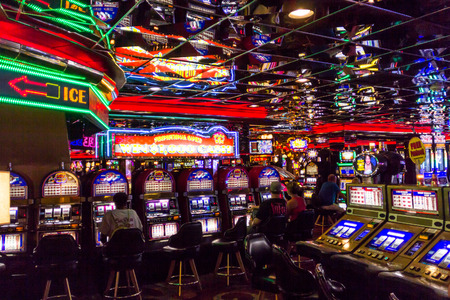 slot machine: Las Vegas, NV, USA - 13th July 2013: People playing slot machine games inside Las Vegas Casino. Editorial