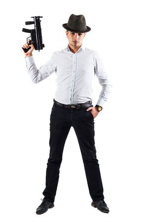 Young italian mobster with hat is holding a weapon - isolated on white photo