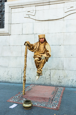 Sevilla, Spain - 18th May 2012: Levitation street performer in central district.