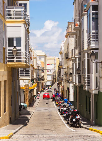 Cadiz, Spain - 19th May 2012: Narrow street in Cadiz neighbourhood.