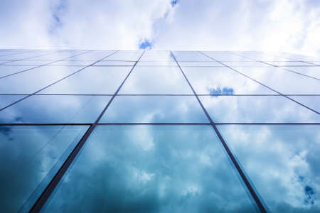 reflects: Full glass modern building reflects the sky and the cluods Stock Photo