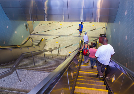 going down: Los Angeles, CA, USA - 6th July 2013: People going down to Hollywood Highland subway station. Editorial