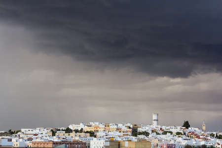 spanish village: A cloudy sky ready for the rain over spanish village. Stock Photo