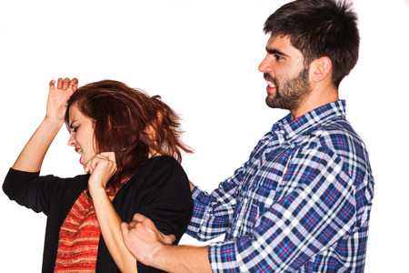 abusing: A man is abusing a woman Stock Photo