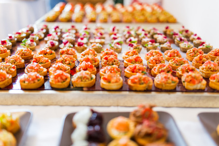 buffet: Different types of canapes on buffet table