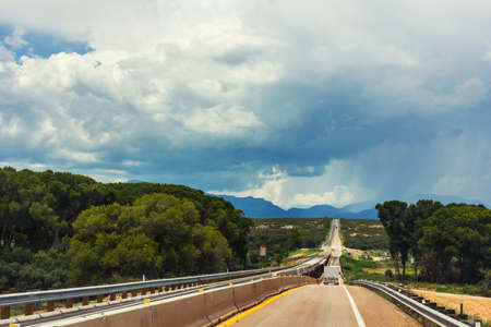 san pedro: Road near San Pedro Riparian National Conservation Area with thunderstorm in the background. Stock Photo