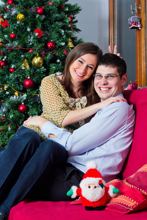 holiday spending: Happy couple spending winter holiday at home