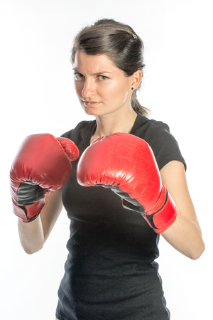 tough woman: Beautiful tough woman wearing red boxing gloves in her hands - isolated on white