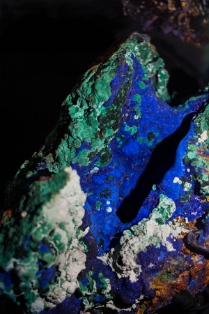 amethyst rough: Vibrant blue azurite mineral sample on a black background.