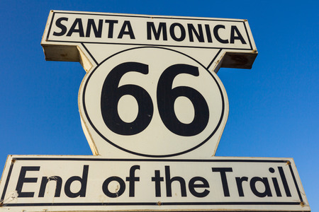 santa monica: Route 66 sign at Santa Monica Pier over blue sky in the background. Stock Photo