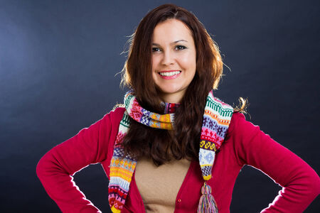 warmly: Portrait of a beautiful woman wearing a warmly scarf