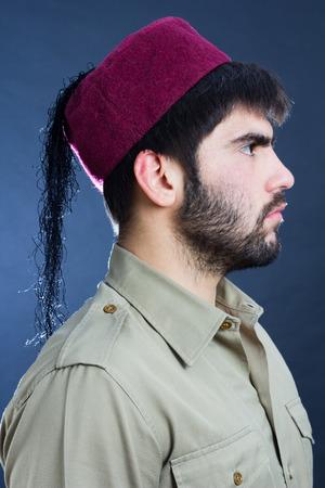 turk: Profile image of a man wearing a turkish cap