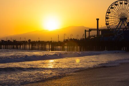 santa monica: Santa Monica Pier and Ferris Wheel at sunset in Los Angeles