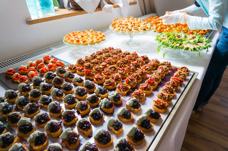 arranging: Arranging different specialties of catering food for an event