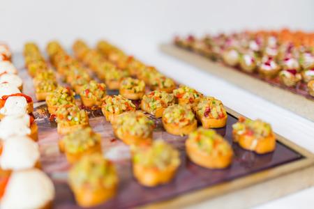 Small various bruschetta arranged for the cold buffet