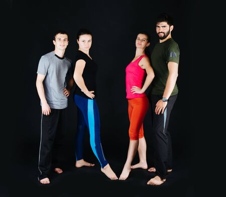 standing together: Fitness workout team made of aerobic and fitness motivated trainers.