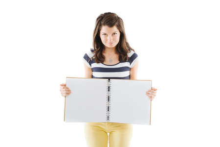 writable: Young standing woman with empty pages scrapbook, isolated on white Stock Photo