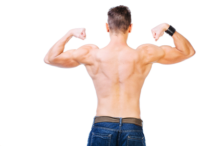 trapezius: Well defined back and biceps of a muscular man - isolated on white. Stock Photo