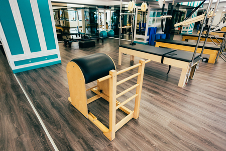 trapeze: Trapeze table, reformer, ladder barrel,exochair in a pilates room