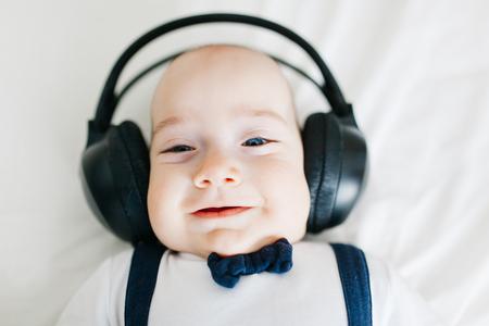 dj boy: Portrait of an adorable dj baby boy with headphones Stock Photo