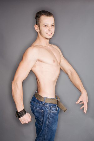 man profile: Profile of a smiling man with well defined muscles Stock Photo