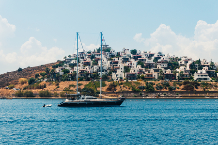 turkey beach: Seascape with anchored sailboat off the beach in Bodrum, Turkey. Stock Photo