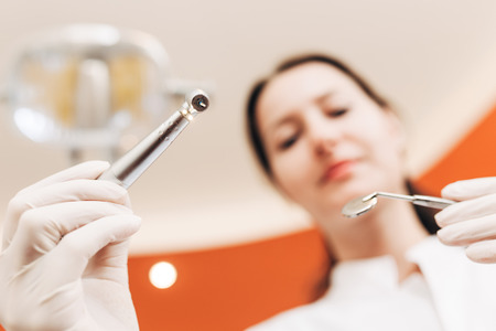 hand tool: Dentist doctor holding dental tools Stock Photo