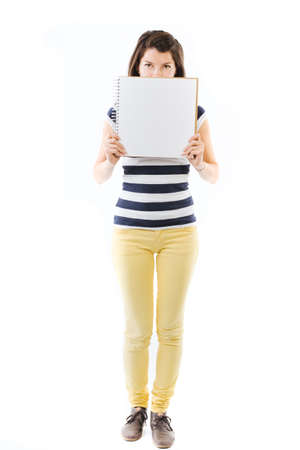 writable: Standing young woman with writable white page - isolated on white Stock Photo